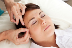 a woman having facial acupuncture treatment